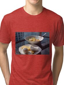 A bowl of cereals and yogurt and a plate with cheese and eggs. Tri-blend T-Shirt