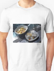 A bowl of cereals and yogurt and a plate with cheese and eggs. T-Shirt