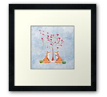 Foxes under a love tree Framed Print