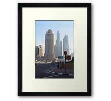 Street with tall buildings from Dubai, United Arab Emirates. Framed Print