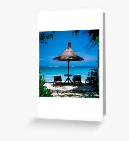 Beach umbrella and recliners, Bali, Indonesia. Greeting Card