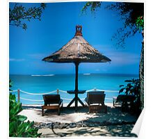 Beach umbrella and recliners, Bali, Indonesia. Poster