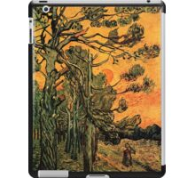 'Pine Trees Against A Red Sky with a Setting Sun' by Vincent Van Gogh (Reproduction) iPad Case/Skin