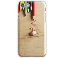 Colored pencils on a wooden board iPhone Case/Skin