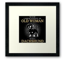 Never Underrestimate An Old Woman Framed Print