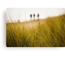 Dune grass with people on beach Canvas Print