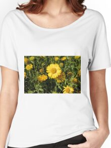 Yellow flowers in the grass. Women's Relaxed Fit T-Shirt