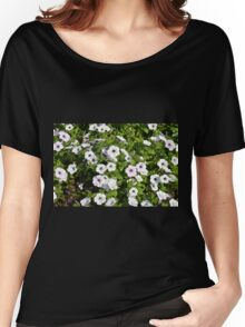 White spring flowers in the park. Women's Relaxed Fit T-Shirt