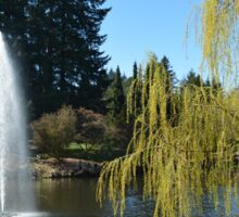 Beautiful spring garden with willow tree by a pond and water fountain Sticker