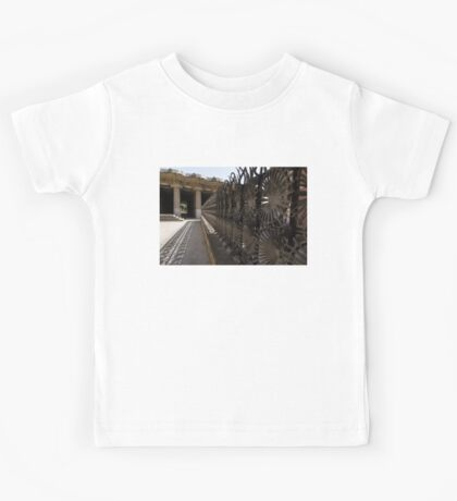 Shadow Play - a Whimsical Wrought Iron Fence by Antoni Gaudi - Park Guell, Barcelona Kids Tee