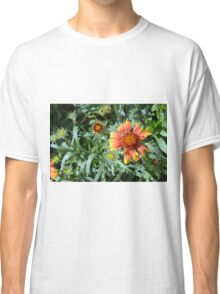 Orange flower and green leaves background. Classic T-Shirt