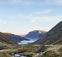 Fog formed in the valley at sunrise. Kirkstone Pass, Cumbria, UK. Sticker