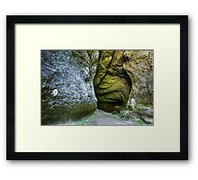 Entrance of a cave with underground river Framed Print