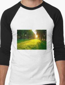 The lawn in the city park at sunset on a summer day Men's Baseball ¾ T-Shirt