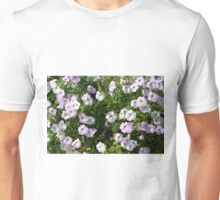 Beautiful pale purple flowers in the garden. Unisex T-Shirt