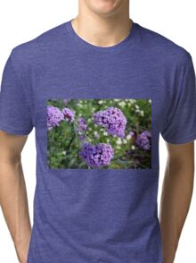 Purple spring flowers in the garden. Tri-blend T-Shirt