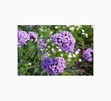 Purple spring flowers in the garden. Unisex T-Shirt