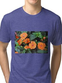 Orange flowers and green leaves. Tri-blend T-Shirt
