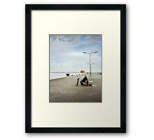 Old man sitting at the dock Framed Print