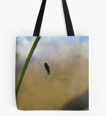 The spider weaves a little while it has audience Tote Bag