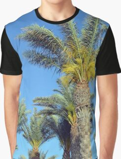 Tall palm trees against the blue sky. Graphic T-Shirt
