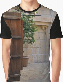 Medieval courtyard with wooden door. Graphic T-Shirt
