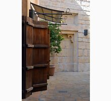 Medieval courtyard with wooden door. Unisex T-Shirt