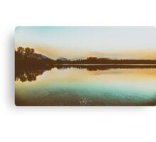sunset on a lake Canvas Print