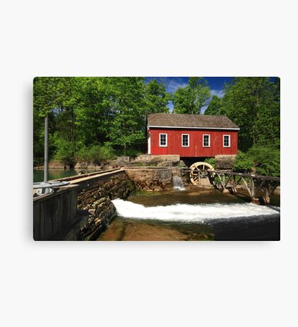 Historical building of Old water sawmill and small dam. Canvas Print
