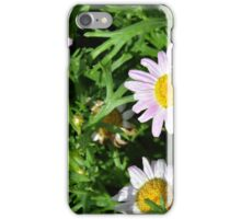 Pink beautiful flowers in the green grass. iPhone Case/Skin