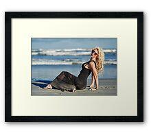 Beautiful woman on the beach Framed Print