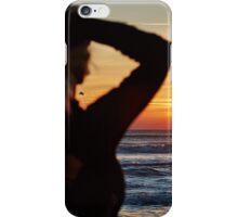 Beautiful woman on the beach at sunrise iPhone Case/Skin