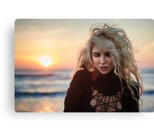 Beautiful woman on the beach at sunrise Canvas Print