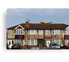 DHL Airbus A300 Emerging From A House Canvas Print