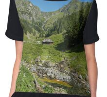 Wooden house in a mountain landscape Chiffon Top