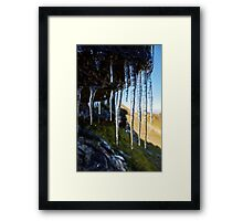 Icicles on a mountain cliff Framed Print