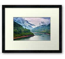 Lake in the mountains on a foggy day Framed Print