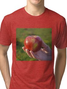 female hand holding an apple Tri-blend T-Shirt