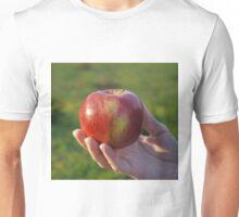 female hand holding an apple Unisex T-Shirt