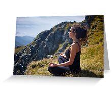 Woman practicing yoga on mountain Greeting Card