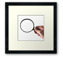 hand and magnifying glass  Framed Print
