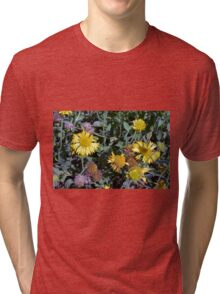Yellow flowers in the garden. Tri-blend T-Shirt
