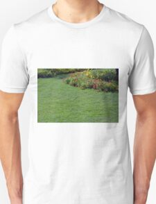 Green lawn and small flowers. T-Shirt