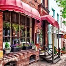Alexandria VA - Red Awnings on King Street by Susan Savad
