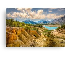Valley wall, reservoir and mountains at Orxeta Canvas Print