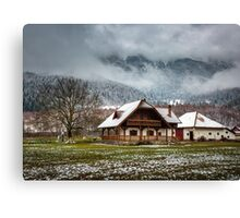 House by the mountains Canvas Print