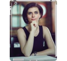 Young beautiful woman waiting in a restaurant iPad Case/Skin