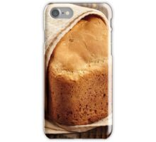 Homemade bread on a wooden board iPhone Case/Skin