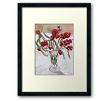 Red gum blossums in glass vase on white Framed Print