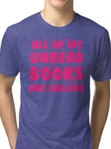 All of my unread books are calling me! Tri-blend T-Shirt